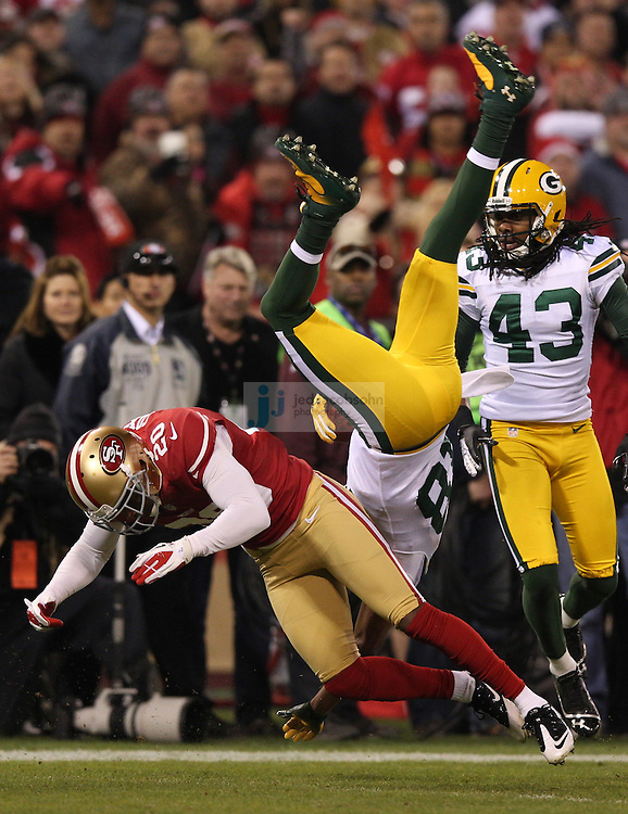 Green Bay Packers wide receiver Randall Cobb (18) is tackled by San Francisco 49ers defensive back Perrish Cox (20) during a NFL Divisional playoff game at Candlestick Park in San Francisco, Calif., on Jan. 12, 2013. The 49ers defeated the Packers 45-31. (AP Photo/Jed Jacobsohn)
