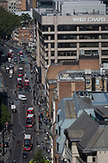 An aerial view eastwards to the A11 Whitechapel Road and the East End, from Aldgate and the City of London, the capital's ancient financial district, on 13th May, in London, England.