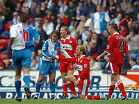 Photo: Back Page Images. 16/10/2004.<br /> Barclays Premiership. Blackburn Rovers v Middlesbrough. Ewood Park.<br /> Tuguy helps Gaizka Mendieta to his feet after bringing him down. Tuguy was sent off for the tackle as it was his second bookiable offence