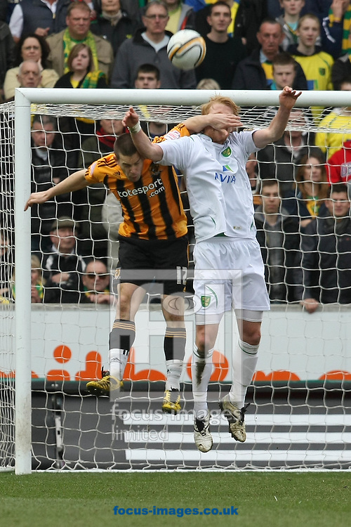 Hull - Saturday March 19th, 2011: Zac Whitbread of Norwich and Matt Fryatt of Hull City in action during the Npower Championship match at The KC Stadium, Hull. (Pic by Paul Chesterton/Focus Images)