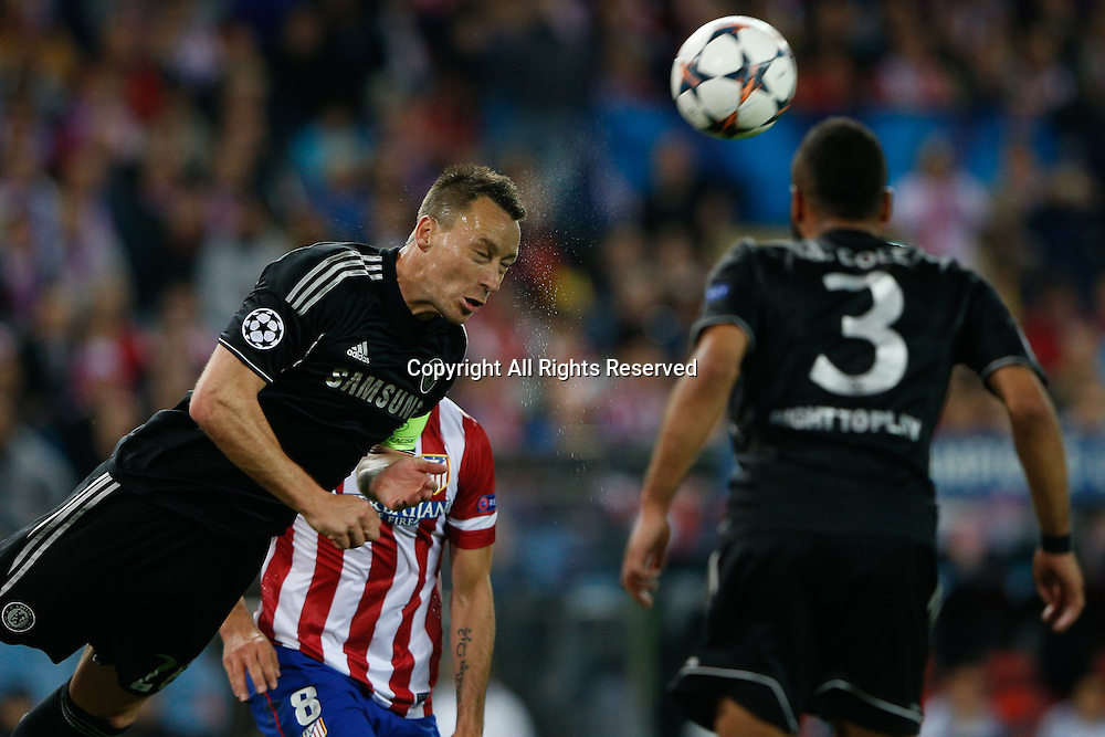 22.04.2014. Madrid, Spain. UEFA Champions League semi-final.  Atletico de Madrid versus Chelsea C.F. at Vicente Calderon stadium.  John Terry of Chelsea clears his line with a strong header
