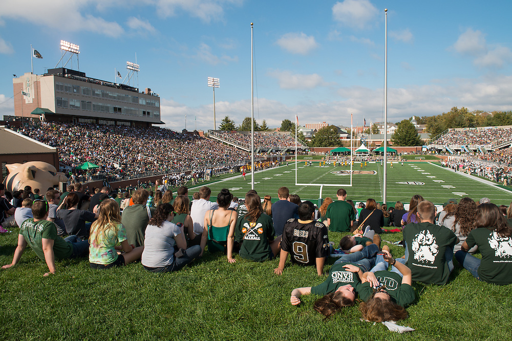 OHIO students Rachel Bonnell (Left) and Hannah Harris (Right) relax at the 2013 OHIO Homecoming football game. Photo by Ben Siegel