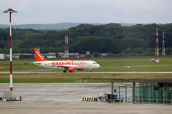 THEMENBILD - EasyJet Flugzeug auf der Landebahn, aufgenommen am EuroAirport Basel-Mülhausen-Freiburg, Frankreich am 11.08.2014 // Feature of the EuroAirport Basel Mulhouse Freiburg, France on on 2014/08/11. EXPA Pictures © 2014, PhotoCredit: EXPA/ Eibner-Pressefoto/ Fleig<br /> <br /> *****ATTENTION - OUT of GER*****