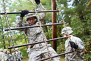 "October 3, 2010 - Fort Devens, MA - Army ROTC freshman cadet Marcin Butkiewicz, 25, climbs down the Cargo Net Climb, one of many obstacles at Fort Devens, Massachusetts that Butkiewicz must complete during the fall field training exercise. He and approximately 40 other Army ROTC freshman and sophomore cadets from several different Massachusetts universities spent a weekend completing tasks that are intended to bolster confidence and promote team building. ""The tasks themselves aren't hard or anything new, but it's cool getting to know the people in my company"" said Butkiewicz, who recently returned from a year of service in Iraq. (Photo by Amy Donnelly, COM 2011)"
