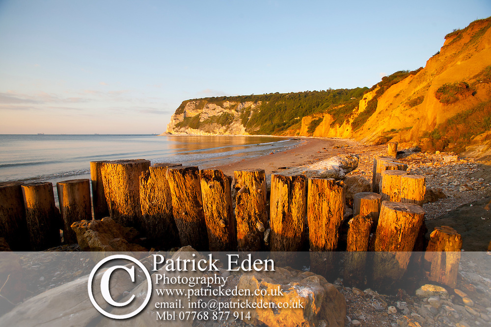 Sunrise Beach Cliffs Shop Whitecliff Bay Isle of Wight England UK Photographs of the Isle of Wight by photographer Patrick Eden photography photograph canvas canvases