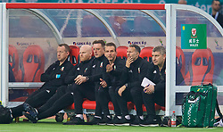 NANNING, CHINA - Thursday, March 22, 2018: Wales' new manager Ryan Giggs on the bench with his staff during the opening match of the 2018 Gree China Cup International Football Championship between China and Wales at the Guangxi Sports Centre. Medical Officer Doctor Jon Houghton, physiotherapist Sean Connelly, goalkeeping coach Tony Roberts, assistant coach Albert Stuivenberg, assistant coach Osian Roberts. (Pic by David Rawcliffe/Propaganda)