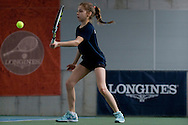 Maja Chwalinska competes during final the Longines Future Tennis Aces 2014 at Tuan Tennis Club in Jozefoslaw near Warsaw on April 12, 2014.<br /> <br /> Poland, Warsaw, April 12, 2014<br /> <br /> Picture also available in RAW (NEF) or TIFF format on special request.<br /> <br /> For editorial use only. Any commercial or promotional use requires permission.<br /> <br /> Mandatory credit:<br /> Photo by © Adam Nurkiewicz / Mediasport