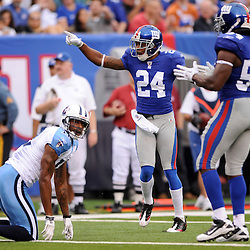 Corner back Terrell Thomas #24 of the New York Giants celebrates a turnover during first half NFL football action between the New York Giants and Tennessee Titans at New Meadowlands Stadium in East Rutherford, New Jersey. The game is tied at half time.