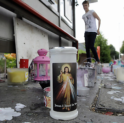 © Licensed to London News Pictures. 09/08/2012 . Candles at the bus stop near Castle Hill School and The Lindens.. Sixth day (09.08.2012) Tia Sharp has been missing..  12 years old Tia Sharp has been missing from the Lindens on The Fieldway Estate in New Addington,Croydon,Surrey since Friday last week. .Photo credit : Grant Falvey/LNP