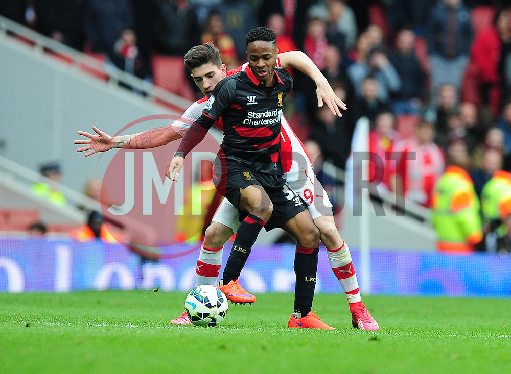 Raheem Sterling of Liverpool shields the ball from Héctor Bellerin of Arsenal - Photo mandatory by-line: Alex James/JMP - Mobile: 07966 386802 - 04/04/2015 - SPORT - Football - London - Emirates Stadium - Arsenal v Liverpool - Barclays Premier League