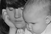 Intimate black and white cluse up portrait of mom and baby.