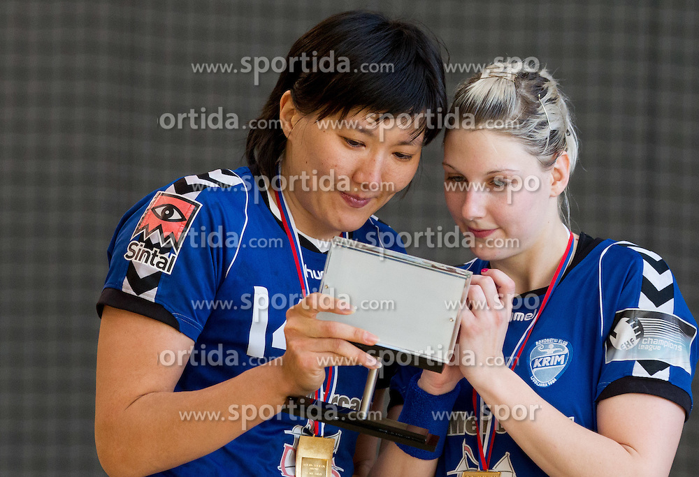 Ljudmila Bodnjeva and Tamara Mavsar of Krim celebrate after the last game of 1st A Slovenian Women Handball League season 2011/12 between ZRK Krka and RK Krim Mercator, on May 8, 2012 in Stopice at Novo mesto, Slovenia. RK Krim Mercator became Slovenian National Champion, GEN-I Zagorje placed second and ZRK Krka placed third. (Photo by Vid Ponikvar / Sportida.com)