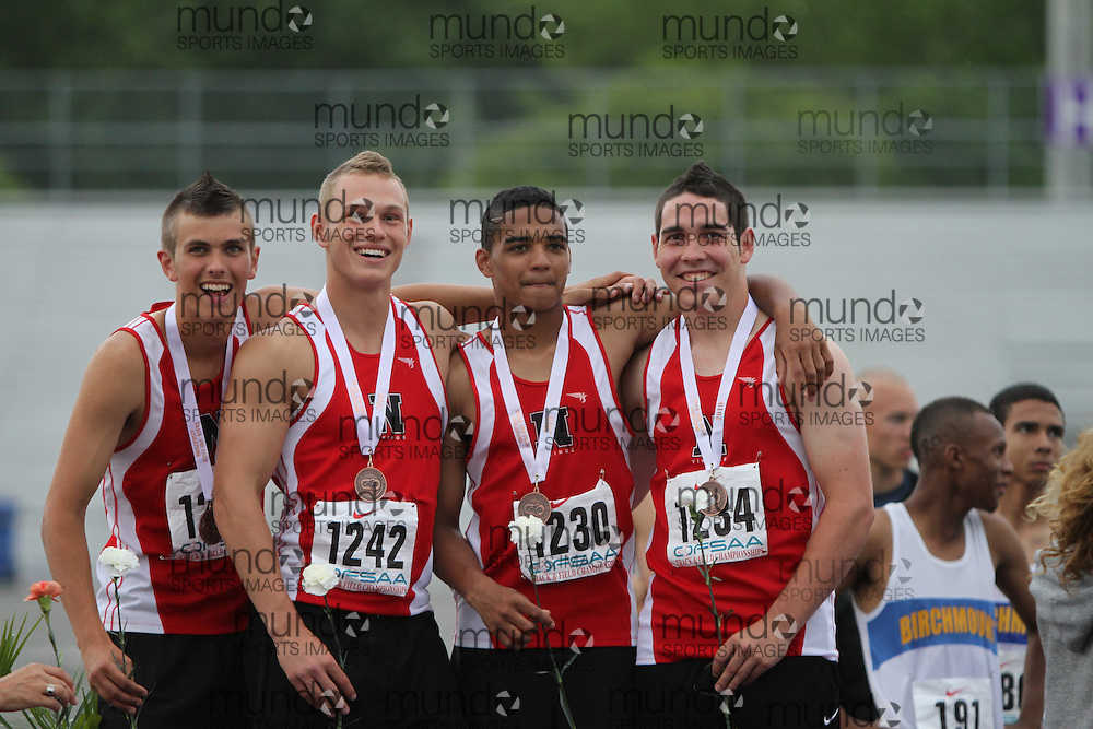 (London, Ontario}---04 June 2010) \\ the senior boys 4X100 meter relay team from Sarnia Northern receive their medals at the 2010 OFSAA Ontario High School Track and Field Championships in London, Ontario,  June 04, 2010. Photograph copyright Laura Barclay / Mundo Sport Images, 2010.