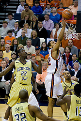 Virginia forward Jamil Tucker (12) scores on a tip in against GT.  The Virginia Cavaliers men's basketball team fell to the Georgia Tech Yellow Jackets 92-82 in overtime at the John Paul Jones Arena in Charlottesville, VA on January 27, 2008.