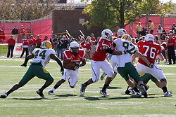 16 October 2010:  Erik Smith plunges towards a hole created by Jordan Neukirch, but Preston Evans closes in during a game where the North Dakota State Bison lost to the Illinois State Redbirds 34-24, meeting at Hancock Stadium on the campus of Illinois State University in Normal Illinois.