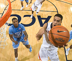 Virginia guard Mustapha Farrakhan (2) shoots a layup past North Carolina forward Deon Thompson (21).  The the #5 ranked North Carolina Tar Heels defeated the Virginia Cavaliers 83-61 in NCAA Basketball at the John Paul Jones Arena on the Grounds of the University of Virginia in Charlottesville, VA on January 15, 2009.