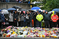 © Licensed to London News Pictures. 06/06/2017. London, UK.       A minutes silence is held at London Bridge in central London for those who lost their life in a terrorist attack on Saturday evening. Three men attacked members of the public  after a white van rammed pedestrians on London Bridge.   Ten people including the three suspected attackers were killed and 48 injured in the attack. Photo credit: Ben Cawthra/LNP