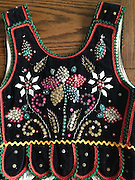 This beautiful Polish krakowianka folk vest always brings precious memories from my childhood in Poland where I was born and raised. I received this special gift from my parents when I was 6 years old, a vivid memory of mine, and I wore the vest during many special cultural events in my school. I brought this vest when I moved to the US, hoping that one day if I were to have a daughter she could wear it to represent her heritage. My dreams came true and my daughter, Natalie, wore this vest during her school's international day celebration. Now the vest is waiting for the next generation. I also have an adult version of this same vest which I wear during the annual International Festival and other Polish cultural celebrations