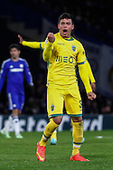 Jonathan Silva of Sporting Clube de Portugal celebrates scoring his team's first goal to make it 2-1 during the UEFA Champions League match at Stamford Bridge, London<br /> Picture by David Horn/Focus Images Ltd +44 7545 970036<br /> 10/12/2014
