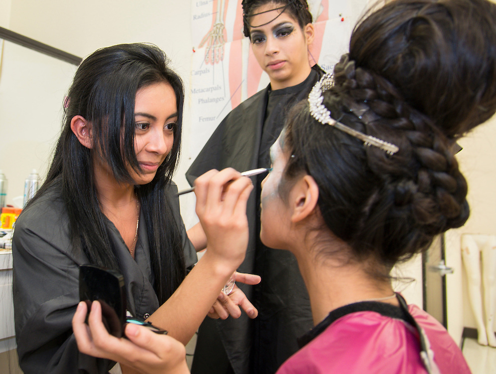 Cosmetology students prepare for the Hair Battle Royale at Barbara Jordan High School, January 13, 2014.