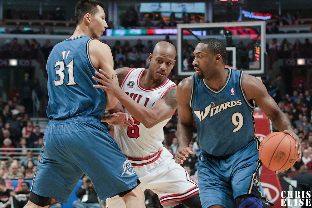 13 November 2010: Washington Wizards' point guard #9 Gilbert Arenas drives past Chicago Bulls' shooting guard #6 Keith Bogans on a screen by Washington Wizards' power forward #31 Yi Jianlian during the Chicago Bulls 103-96 victory over the Washington Wizards at the United Center, in Chicago, Illinois, USA.