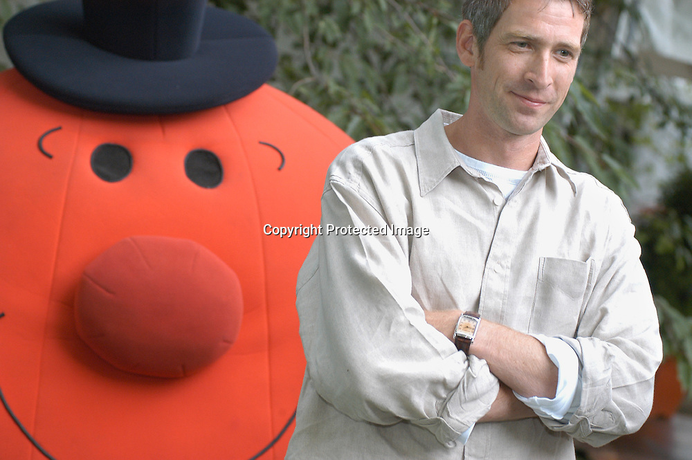 British writer Adam Hargreaves, author of the Mr Men, with one of his creations at the Edinburgh International Book Festival 2003.<br /> <br /> Copyright Pascal Saez<br /> Pascal Saez / Writer Pictures