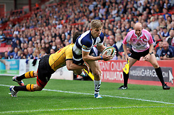 Auguy Slowik of Bristol Rugby looks to score a try before being bundled into touch - Photo mandatory by-line: Patrick Khachfe/JMP - Mobile: 07966 386802 21/09/2014 - SPORT - RUGBY UNION - Bristol - Ashton Gate - Bristol Rugby v Cornish Pirates - GK IPA Championship.