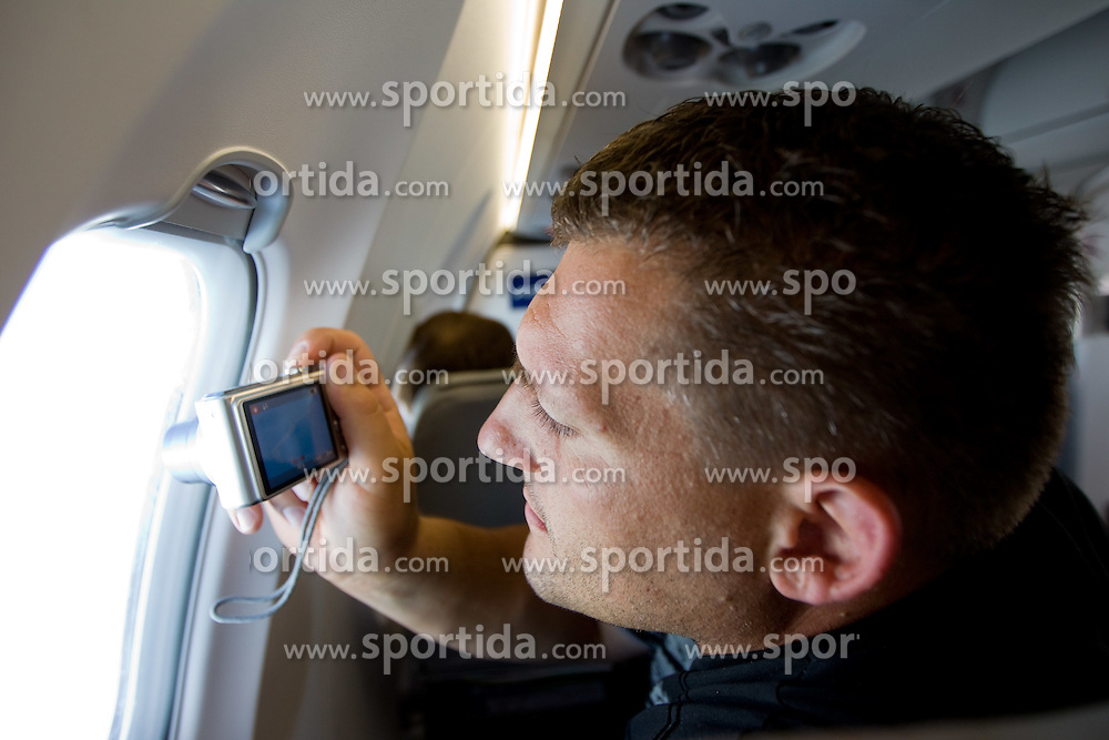 Miro Vodovnik taking picture in an aircraft of team Slovenia at the end of European Athletics Championships Barcelona 2010, on August 2, 2010, Barcelona, Spain. (Photo by Vid Ponikvar / Sportida)