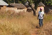 Abdulai Sadia walks through the community of Kunayili, near Gushegu, Northern Ghana, on Wednesday November 2, 2011.