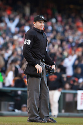 June 12, 2011; San Francisco, CA, USA;  MLB umpire Mike Estabrook (83) stands behind home plate during the sixth inning between the San Francisco Giants and the Cincinnati Reds at AT&T Park. San Francisco defeated Cincinnati 4-2.