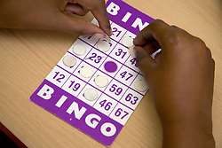 Child playing Bingo at nursery school