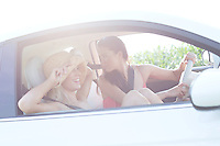 Happy female friends enjoying road trip