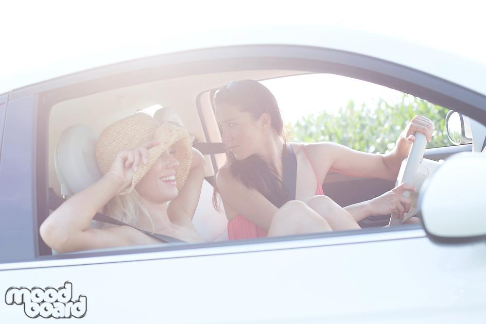 Happy female friends enjoying road trip