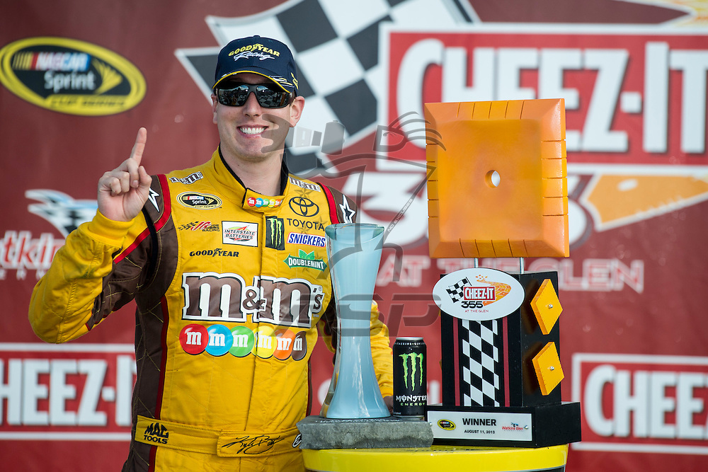 Watkins Glen, NY - AUG 11, 2013: Kyle Busch (18) wins the Cheez-It 355 at The Glen at the Watkins Glen International in Watkins Glen, NY.
