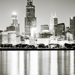 Vertical Chicago skyline at night in black and white with Willis Tower (formerly Sears Tower) one of the world's tallest buildings. Photo taken in late 2011.