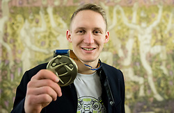 Tilen Kodrin posing with his bronze medal after he signed the City of Ljubljana's Golden Book during reception of Slovenian National Handball Men team after they placed third at IHF World Handball Championship France 2017, on January 30, 2017 in City hall, Ljubljana centre, Slovenia. Photo by Vid Ponikvar / Sportida