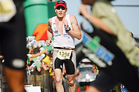 JEROME A. POLLOS/Press..Tom Lamphier makes his way toward the finish line to secured 82nd place finish.