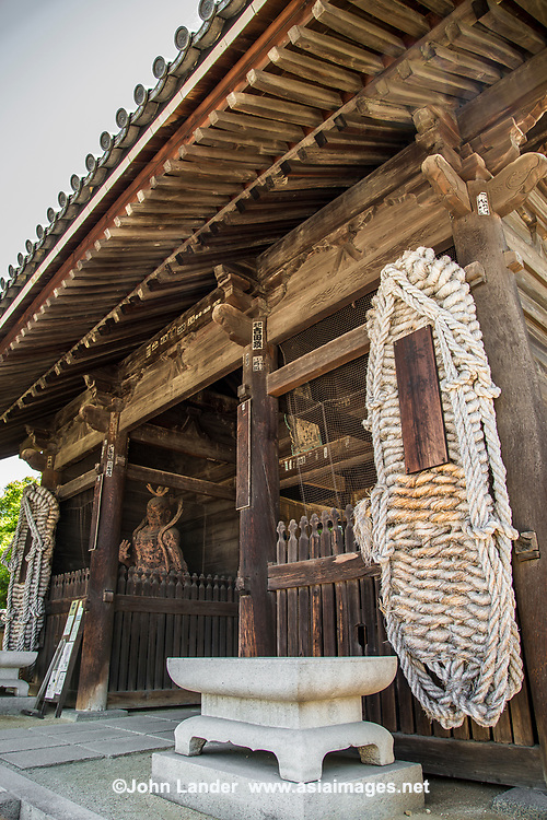 Shido-ji Temple Gate - Shidoji is the 86th temple in the Shikoku Pilgrimage Buddhist trail.  Large straw sandals are prominent as a welcome deocration to the temple, popular with henro pilgrims towards the end of their long journey.