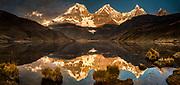 Carhuacocha lake, sunrise reflections, panorama on Siula Grande, Yerupaja and Jirishanca peaks, Andes mountains, Cordillera Huayhuash, northern Peru
