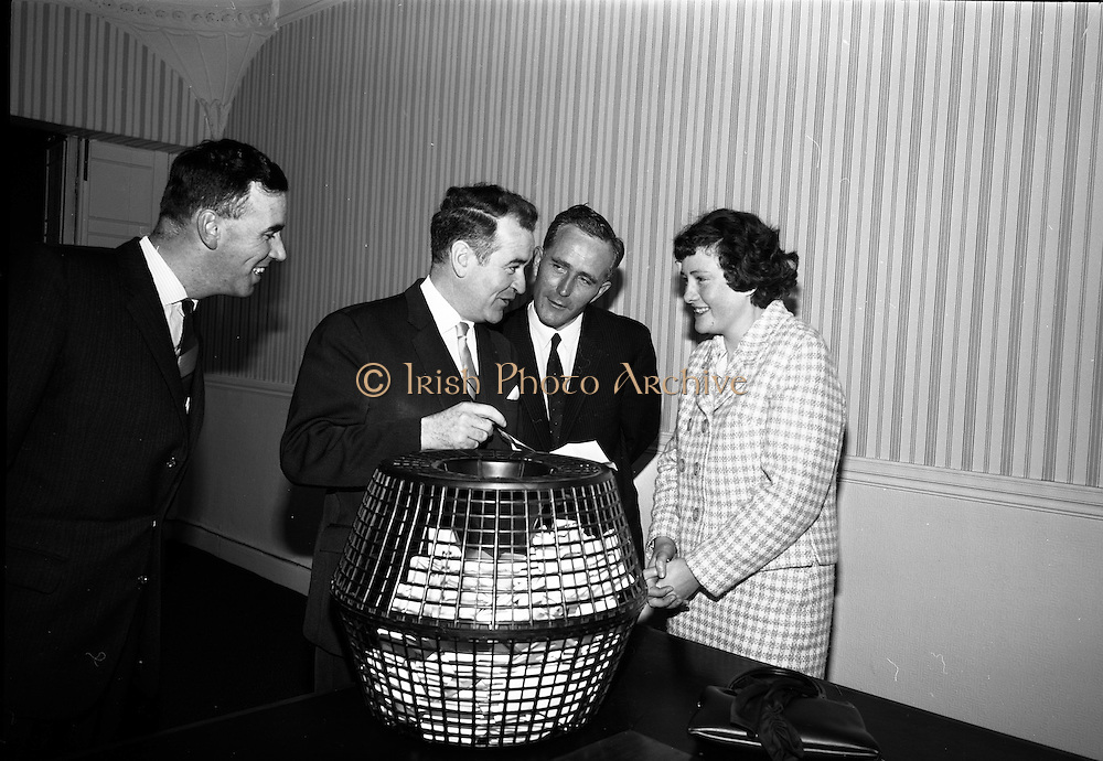 14/05/1965<br /> 05/14/1965<br /> 14 May 1965<br /> Bord Iascaigh Mhara draw at BIM offices, Mount Street, Dublin. Miss Mary Kenny, &quot;National Seafood Cook 1965&quot; from Donaghmore, Dundalk drawing the winning quiz form tat forecasted her as the winner of the National Fish Cookery Competition. The quiz was held at the Fisheries Pavillion at the Spring Show. The winning entry was submitted by Mr Jim Kenny,23 Kenilworth Road, Rathgar, Dublin.