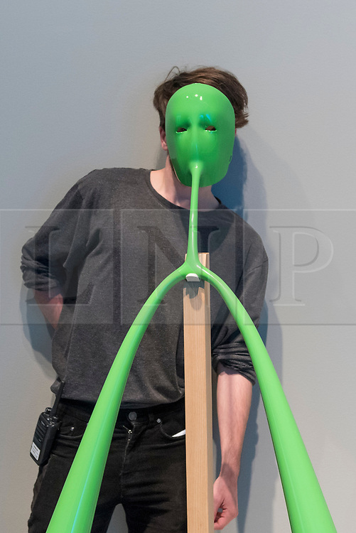 """© Licensed to London News Pictures. 20/11/2019. LONDON, UK. A staff member poses next to """"Designs for an Overpopulated Planet: Foragers"""", 2009, by Dunne & Raby. Preview of """"Eco-Visionaries"""" exhibition at the Royal Academy of Arts in Piccadilly.  The exhibition examines humankind's ecological impact on the planet through works from 21 international practitioners using a variety of media.  The show runs 22 November to 23 February 2020.  Photo credit: Stephen Chung/LNP"""