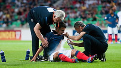 Doctors helping Corentin Jean of France that is lying on the ground after crash with Marc Oliver Kempf of Germany during the UEFA European Under-17 Championship Group A match between Germany and France on May 10, 2012 in SRC Stozice, Ljubljana, Slovenia. Germany defeated France 3:0. (Photo by Matic Klansek Velej / Sportida.com)