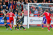 Accrington Stanley midfielder Sean McConville (11) chips the ball in to score Accrington Stanley's 2nd goal to make the score 2-0 during the EFL Sky Bet League 1 match between Accrington Stanley and AFC Wimbledon at the Fraser Eagle Stadium, Accrington, England on 22 September 2018.