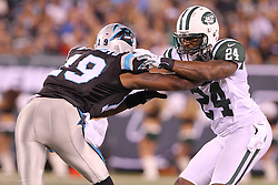 Aug 26, 2012; East Rutherford, NJ, USA; New York Jets cornerback Darrelle Revis (24) defends against Carolina Panthers wide receiver Seyi Ajirotutu (19) during the first half at MetLife Stadium.
