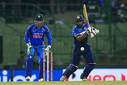 August 24, 2017 - Kandy, Sri Lanka - Sri Lankan cricketer Chamara Kapugedera(R)  plays a shot as Indian wicket keeper Mahendra Singh Dhoni(L) looks on during the 2nd One Day International cricket match between Sri Lanka and India at the Pallekele international cricket stadium at Kandy, Sri Lanka on Thursday 24 August 2017. (Credit Image: © Tharaka Basnayaka/NurPhoto via ZUMA Press)