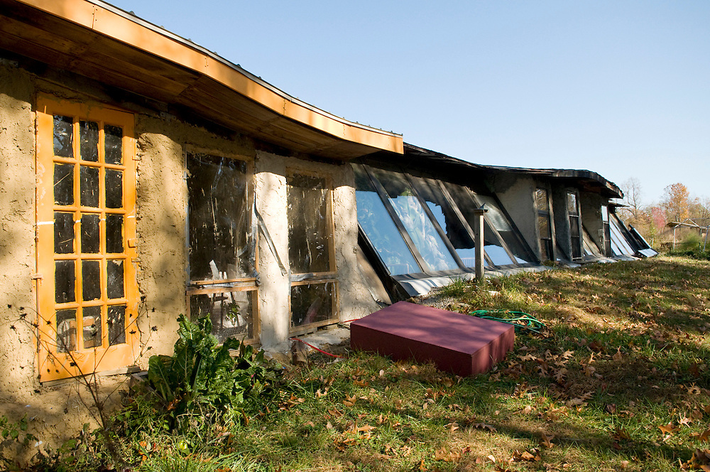 "The ""earthship"" at Blue Rock Station is made largely of tires, cans, bottles, straw, and plaster and uses the principle of thermal mass to regulate the indoor temperature."