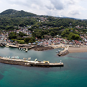 Aerial panorama of Kawana fishing port on the eastern side of the Izu Peninsula in Shizuoka Prefecture, Japan. This layout is typical of small fishing ports throughout Japan.