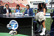 The Los Angeles Rams cheerleaders join Rob Fukuzaki (right), the weekday ABC7 sports anchor for Eyewitness News channel 7 television, as part of the media hoopla surrounding the return of the Los Angeles Rams to the Los Angeles Memorial Coliseum for the Rams 2016 NFL preseason football game against the Dallas Cowboys on Saturday, Aug. 13, 2016 in Los Angeles. The Rams won the game 28-24. (©Paul Anthony Spinelli)