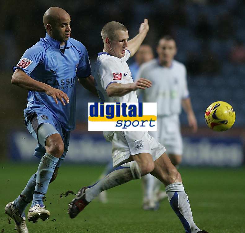 Photo: Lee Earle.<br /> Coventry City v Southend United. Coca Cola Championship. 30/12/2006. Coventry's Leon McKenzie (L) battles with Peter Clarke.