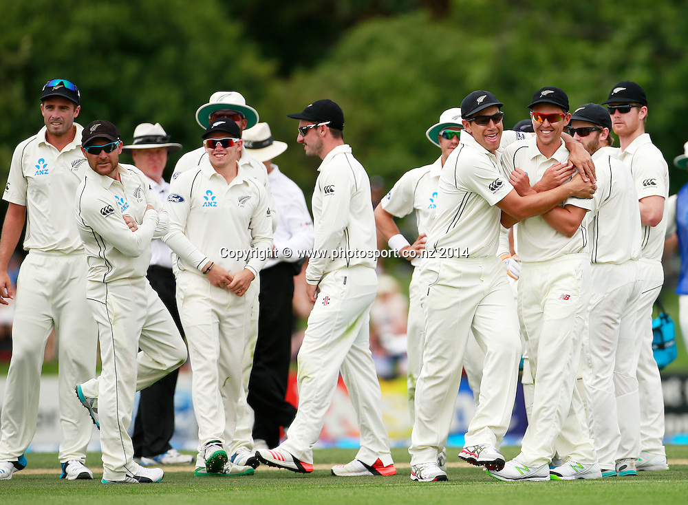 Ross Taylor of the Black Caps and Trent Boult react to a Sri Lankan wicket with the rest of the team on Day 2 of the boxing Day Cricket Test Match between the Black Caps v Sri Lanka at Hagley Oval, Christchurch. 27 December 2014 Photo: Joseph Johnson / www.photosport.co.nz